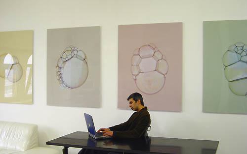 artist in studio with photograms